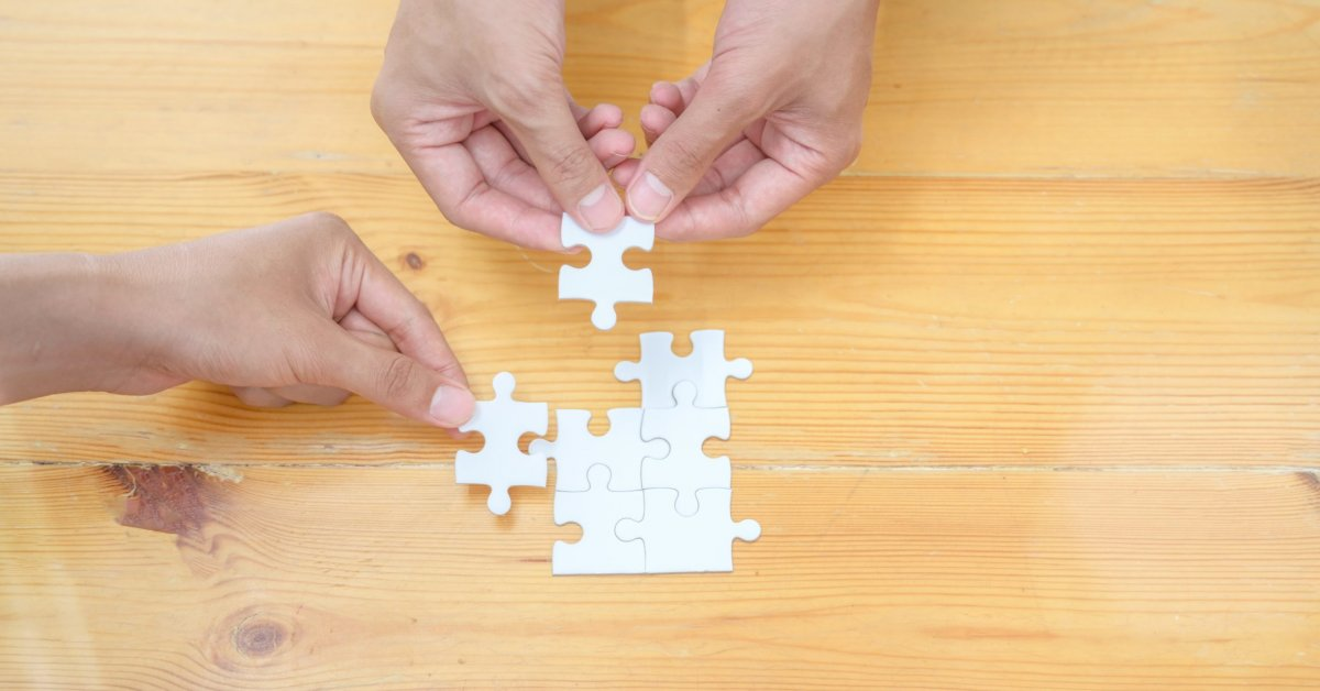 person-holding-white-jigsaw-puzzle-piece-3740380